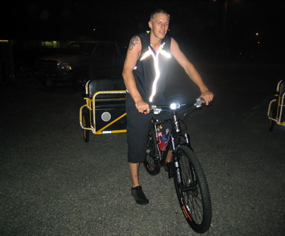 Bicycle taxi in Avalon, NJ. Dude supplies power for the lights with a car battery tucked inside the sled
